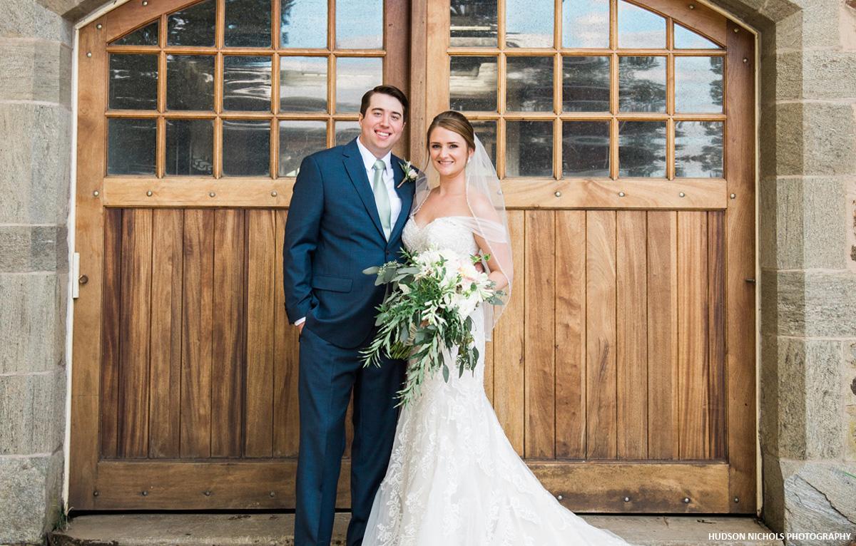 Bride & groom in front of door