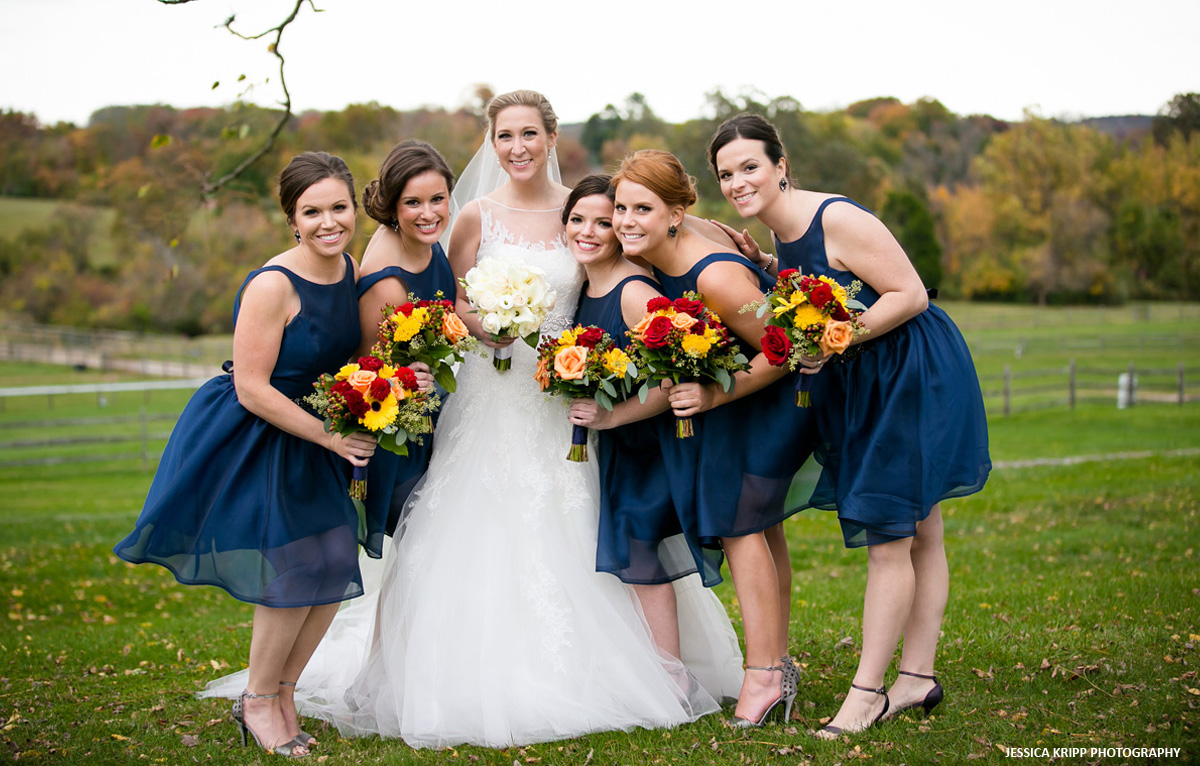 Bride and her bridesmaids on the grounds of Radnor Hunt