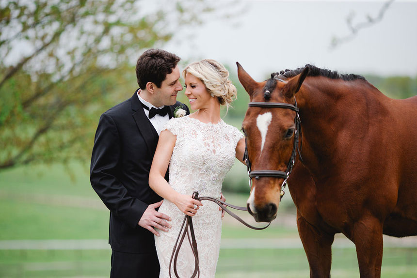 Bride and Groom Pose with Horse at Radnor Hunt