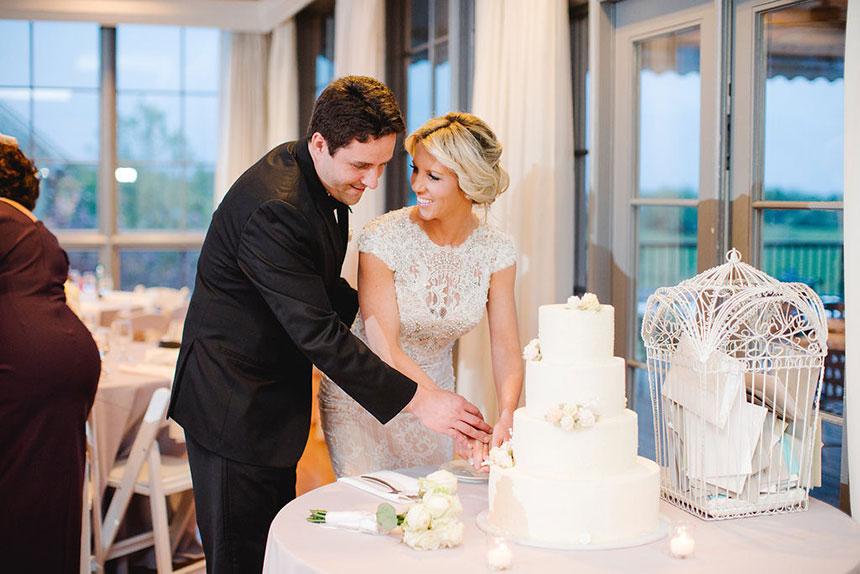 Bride and Groom Cut Cake at Radnor Hunt