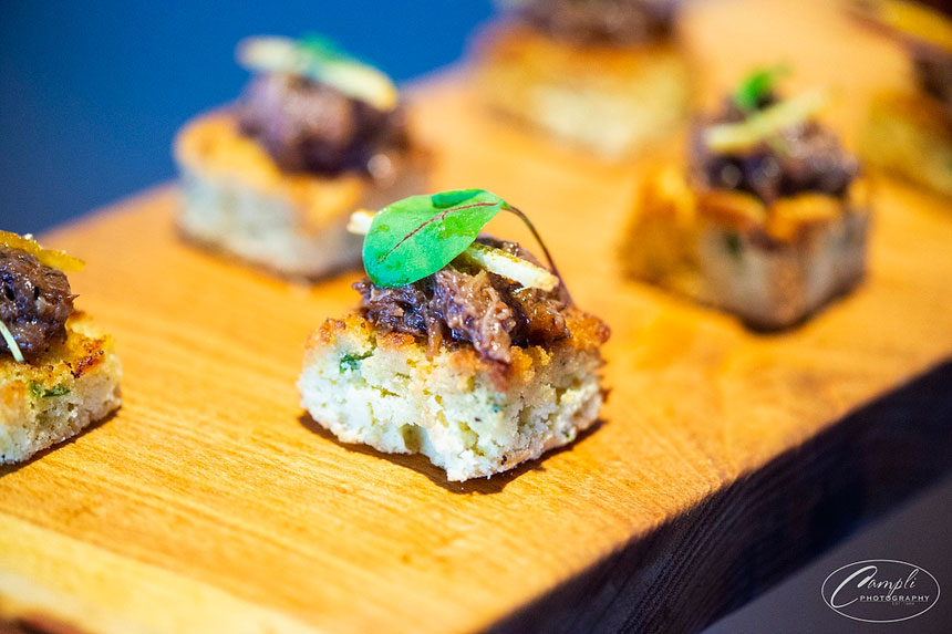 Braised short rib on jalapeno cheddar cornbread with candied orange zest