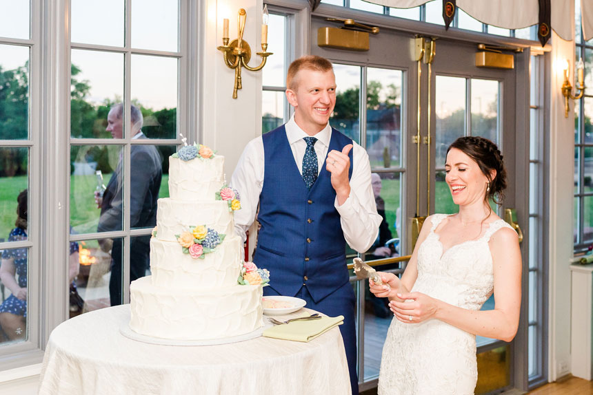 Bride and Groom Cut Cake at Radnor Hunt Wedding
