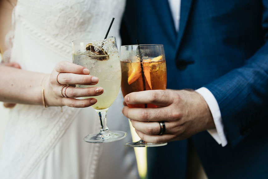Bride and Groom Hold Custom Cocktails